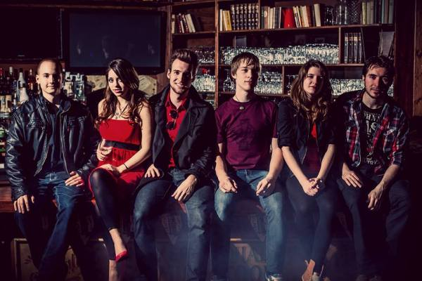 left to right: András Tóth - electric guitar Dominika Mészáros - violin Dániel Fekete-Szűcs - vocals, acoustic guitar Gábor Ridly - drums Júlia Seres - flute Aurél Czövek - bass